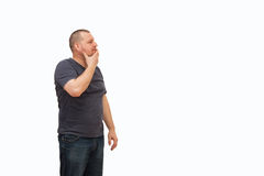 The man creates an image gestures and a mimicry. The man creates an image of reflexion holding one hand at a chin, and another having lowered downwards, on the Royalty Free Stock Photos