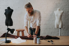 Man creating new clothes in parlour stock photo