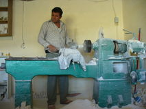 Man creating travertine figures Stock Image