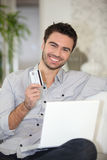 Man with credit card Stock Photography