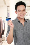 Man with credit card Stock Image