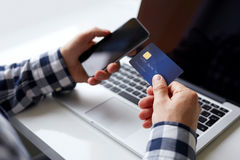 Man with credit card and mobile phone Royalty Free Stock Photography