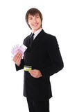 Man with the credit card and money is smiling Stock Photos