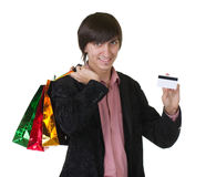 Man with credit card and shopping bags Stock Photography