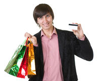 Man with credit card and shopping bags Stock Photo