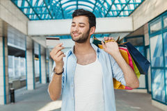 Man with credit card and shopping bags Royalty Free Stock Photos