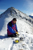 Man on crest, in winter Stock Photo
