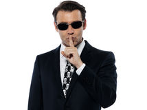 Man criminal hushing silence Stock Photography