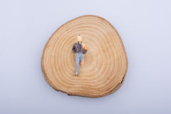 Man with crippled  leg on a wood log cut in round pieces Stock Images