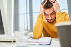 Man with a crisis or problem. Stressed man with a crisis or problem in his office Stock Photos