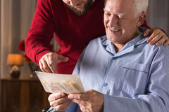 Man with critical illness. Photo of elderly men with critical illness having positive attitude Royalty Free Stock Photos