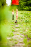 Man cross country running on trail Stock Image