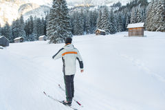 Man on cross country ski in snow covered mountains Royalty Free Stock Images