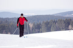 Cross-country skiing. A man cross-country skiing in front of winter landscape Stock Image