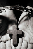 Man with a cross and a crown of thorns Stock Photos