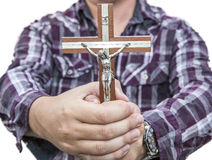 Man with the cross in hands Royalty Free Stock Photo