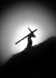 A man with a cross on his shoulder Stock Photos
