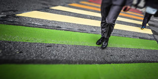 Man cross street at crosswalk in the city Royalty Free Stock Photography