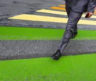 Man cross street at crosswalk in the city Royalty Free Stock Photo