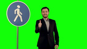 Man cross walk sign on a Green Screen stock footage