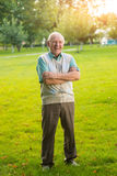 Man with crossed arms laughing. Senior male standing outdoor. Only I understand your jokes. Good mood guaranteed Royalty Free Stock Images