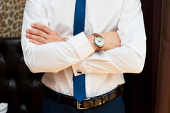 Man with crossed hands. In white shirt with tie Royalty Free Stock Image