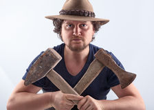 Man with crossed tools Stock Image