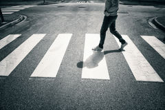 Man crossing city street at crossroad choice sign Royalty Free Stock Photography