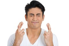 Man crossing fingers Royalty Free Stock Images