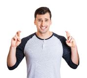 Man crossing fingers Royalty Free Stock Photography
