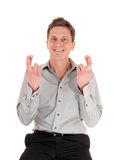 Man crossing fingers Royalty Free Stock Photo