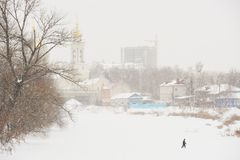 Man crossing ice covered river Royalty Free Stock Photo