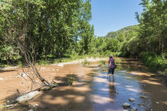 Man crossing a river Royalty Free Stock Images