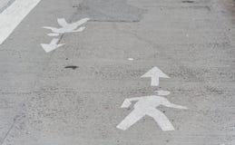 Man Crossing Road Symbol. Stock Photography
