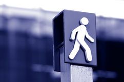 Man crossing sign and symbol Royalty Free Stock Image