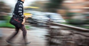 Man crossing the street at a crosswalk. Royalty Free Stock Image