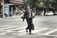 A man crossing the street in New York. City Stock Image