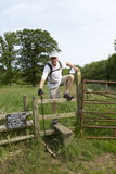 Man Crossing Stile on Thames Path Royalty Free Stock Image