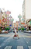 A man crossing yaowarat street. Yaowarat street is the china town in bangkok. many gold shops and chinese restaurants open for business here Royalty Free Stock Photography
