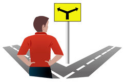 Man at a crossroads. Has a choice of the way forward in life Royalty Free Stock Images