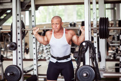 The man crouches with a barbell Stock Photography