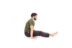 Man in crow pose Stock Photo