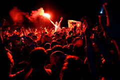 Man from the crowd with a burning flare at FIB Festival Royalty Free Stock Photos
