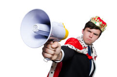 Man with crown and megaphone Stock Image