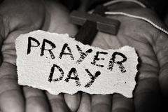 Man with crucifix and text prayer day Stock Photography