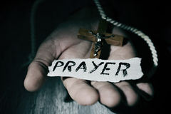 Man with crucifix and word prayer Royalty Free Stock Images