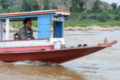 Man cruising on a boat in river Mekong Royalty Free Stock Image
