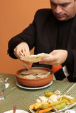 Man crumbles dry lavash Stock Photos