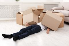 Man crushed underneath cardboard boxes. He was carrying. Heavy shopping, burden concept Royalty Free Stock Photos