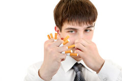 Man Crushing a Cigarettes Royalty Free Stock Photos